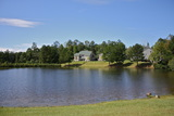Resident Houses for boarding students, each staffed by caring Houseparents, surround a small lake.